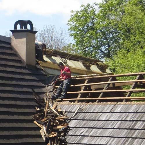 contractor repairing roof
