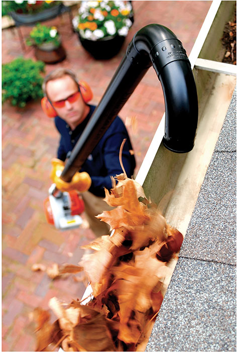 leaf blower to clear the gutter